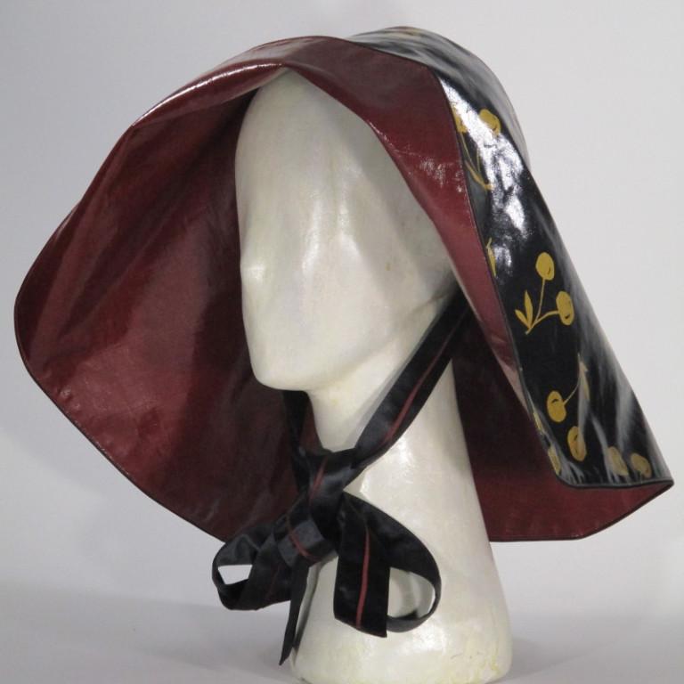 Kopfbedeckung - Damen Regenhut - schwarz gold rot