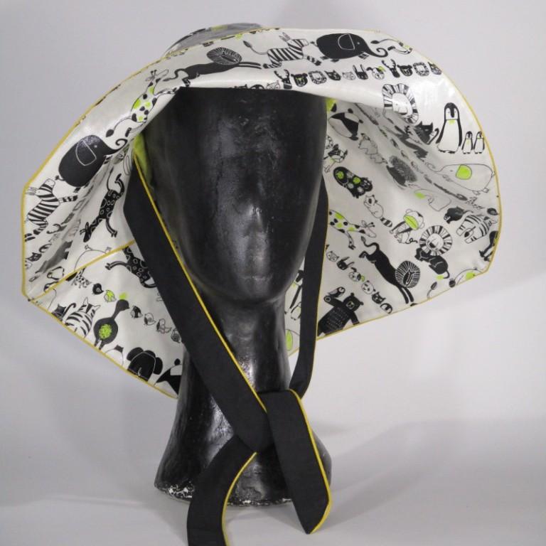 Kopfbedeckung - Regenhut - Tiere schwarz weiß gelb
